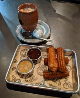 Pro tip: Order both churro dips — chocolate and caramel — for only 25 cents extra. - CHEY SCOTT PHOTO