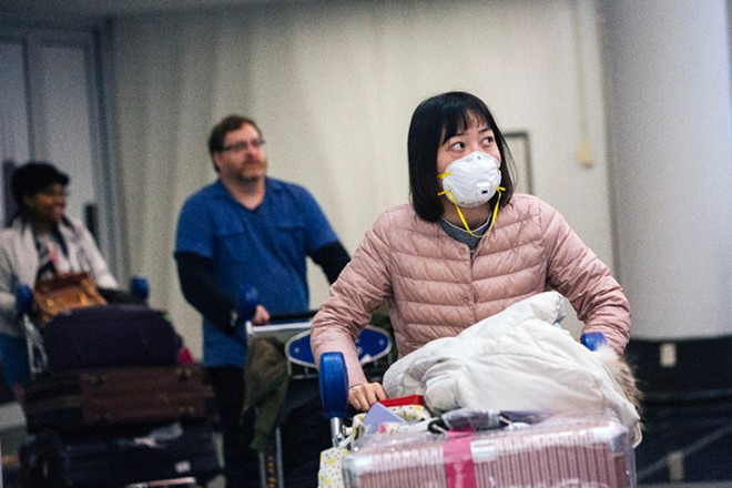 Travelers arrive at O'Hare International Airport in Chicago on Jan. 24, 2020. Health officials around the country are struggling to keep up with costs of screening passengers from China and other parts of the world. - TAYLOR GLASCOCK/THE NEW YORK TIMES