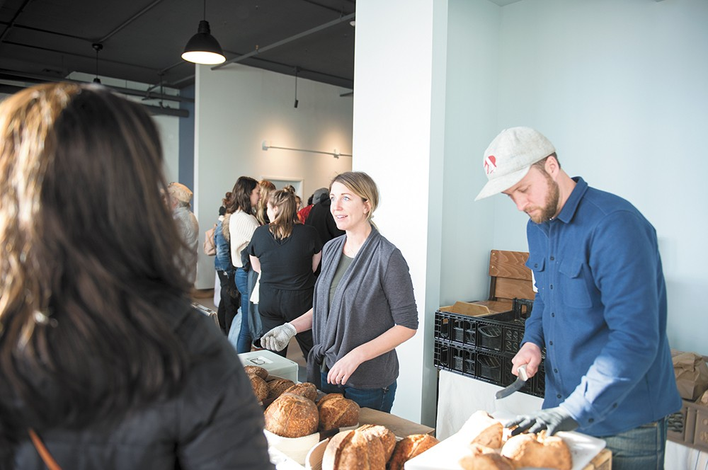 MaK Bread owners Krystle (middle) and Matt Toman at the Lumberbeard Winter Markets. - DEREK HARRISON PHOTO