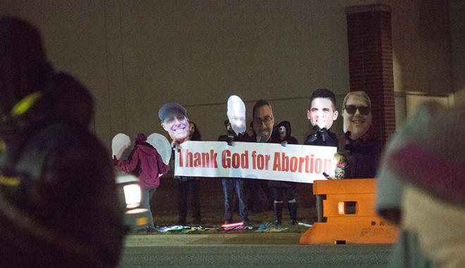 Planned Parenthood has repeatedly asked counter-protesters like these to quit it. In recent months, the numbers of counter-protesters have dwindled as a result. - DANIEL WALTERS PHOTO