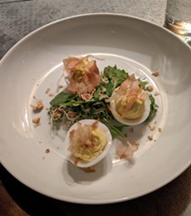 Deviled duck eggs, with bonito flakes, wild greens and a duck fat vinaigrette. - CHEY SCOTT PHOTO