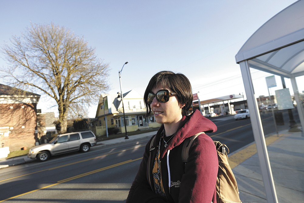 Mariah Geis waiting for the No. 4 bus. - YOUNG KWAK PHOTO