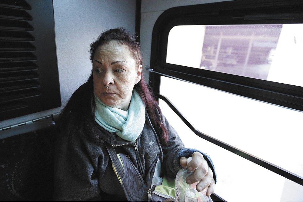 """Sharon Belton, who rides the bus on a daily basis during her commute from central Spokane to Spokane Valley to do home health care work. """"It's pretty efficient,"""" Belton says. """"It's more relaxing than having to actually be the driver and deal with all the chaos."""" - YOUNG KWAK PHOTO"""