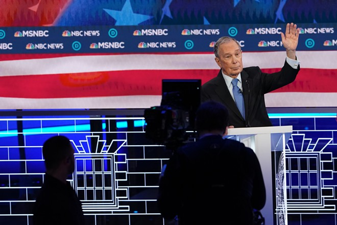 Michael Bloomberg waves from the stage of the Democratic presidential primary debate in Las Vegas, Feb. 19, 2020. - ERIN SCHAFF/THE NEW YORK TIMES