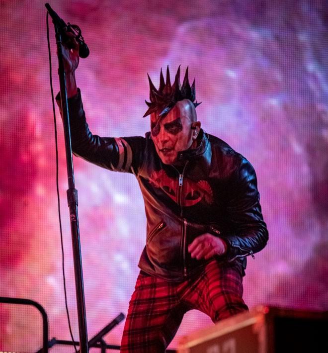 Maynard James Keenan crouches through Tool's show at Spokane Arena Monday night. - ERICK DOXEY