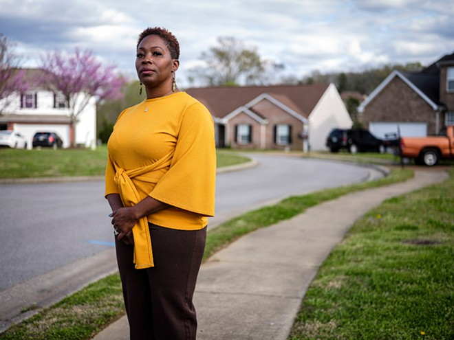 Erica Battle, an education consultant, outside her home in the Nashville suburb of Mount Juliet, April 1, 2020. April was meant to be one of her busiest months, as schools rush to get students ready for standardized testing season. Instead, she is home with her husband and teenage son, trying to figure out how to cut expenses. - WILLIAM DESHAZER/THE NEW YORK TIMES