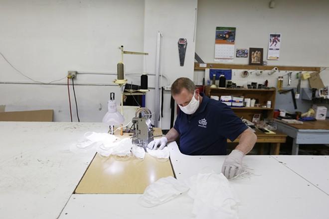 Upholsterer Jay Dupuis sews non-medical masks. - YOUNG KWAK PHOTO