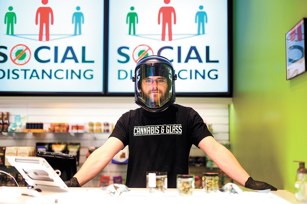 A staffer at Cannabis & Glass is ready to help you. - ADAM SCHLUTER PHOTO