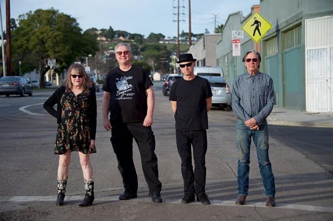 X is (left to right) Exene Cervenka, Billy Zoom, DJ Bonebrake and John Doe.
