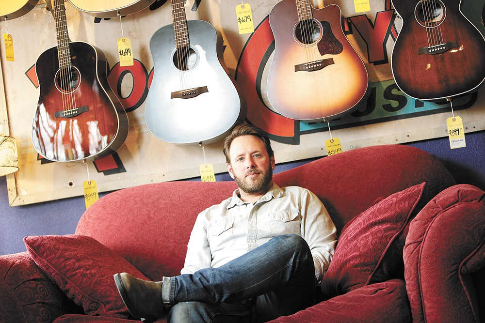 Nate Corning, owner of Mark's Guitar Shop, missed out in the first round of the Payroll Protection Program loan. - YOUNG KWAK PHOTO