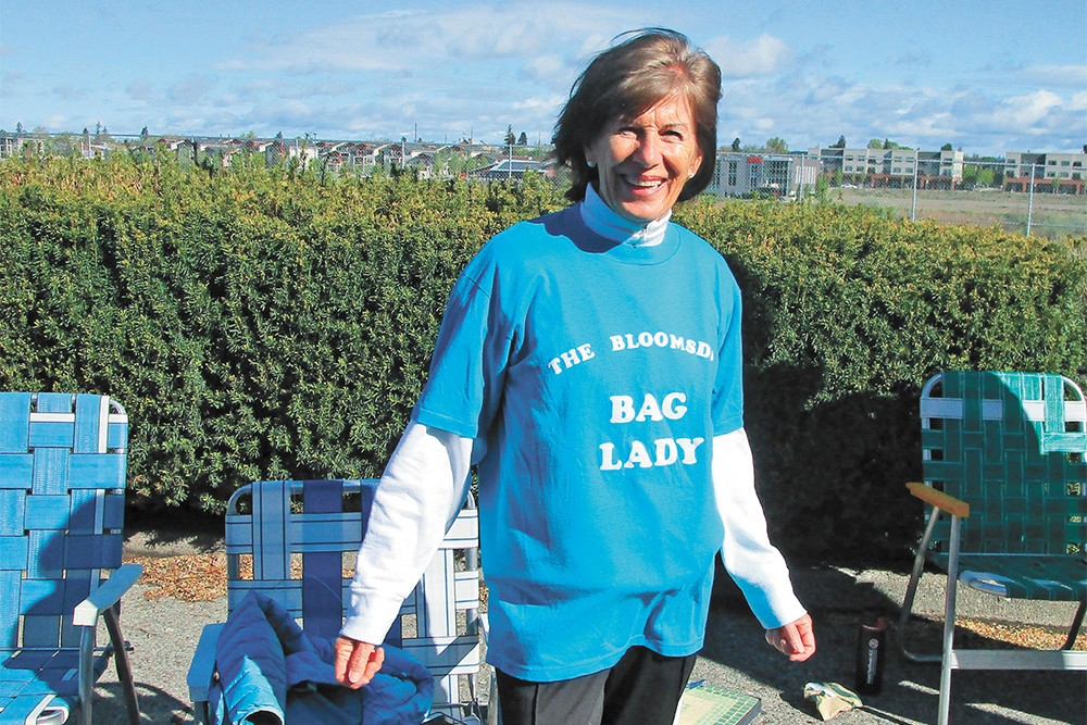 Kathleen Dix cheered on the unofficial Bloomies Sunday, subbing in for her 100-year-old mother. - DAN NAILEN PHOTO
