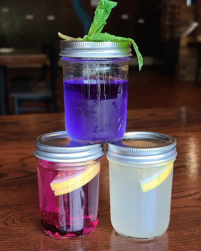 A colorful trio of cocktails to-go from Downriver Grill's signature drinks menu. - DOWNRIVER GRILL