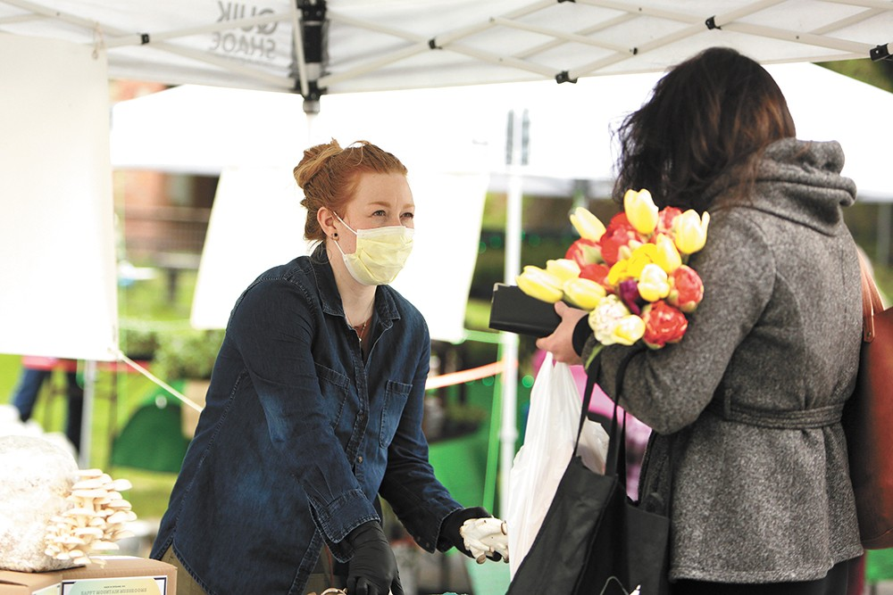 Happy Mountain Mushrooms co-owner Krysta Froberg helps a customer at the South Perry Thursday Market. - YOUNG KWAK PHOTO