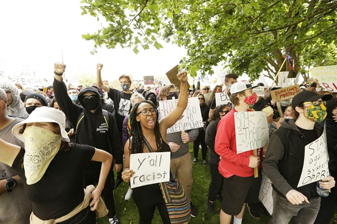 Demonstrators yell at the county courthouse. - YOUNG KWAK