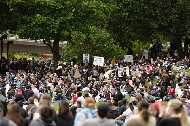 The scene at today's protest in the Lilac Bowl in Riverfront Park. - YOUNG KWAK PHOTO