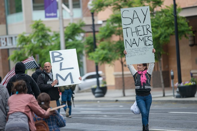 "A Spokane protester includes ""Otto Zehm,"" a Spokane man who died after being beaten and hogtied by police in 2017, on the list of names of victims of police violence. - DANIEL WALTERS PHOTO"