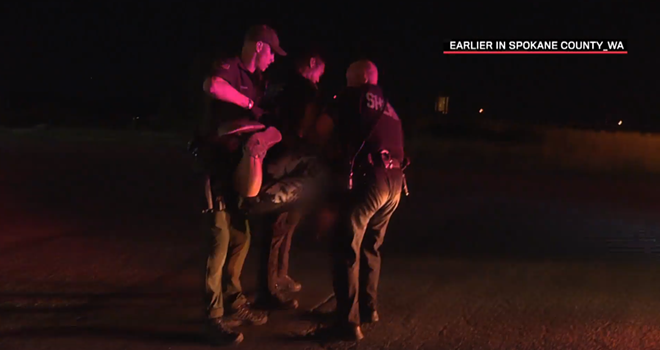 "In a Live PD clip titled ""Hothead Hogtie,"" Spokane County sheriff deputies confront a ""suspicious person"" about why she was walking on the wrong side of the road, and when she remains uncooperative, hog-tie her and lug her to their vehicle. - LIVEPD SCREENCAP"