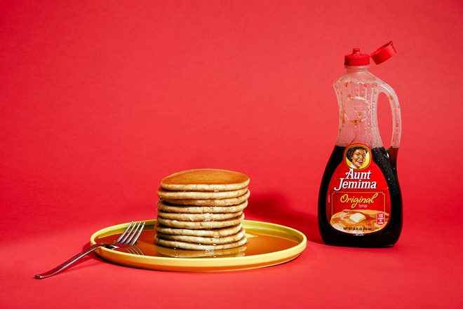 """A bottle of Aunt Jemima brand pancake syrup in New York on April 3, 2020. Aunt Jemima, a syrup and pancake mix brand, will get a new name and image after Quaker Oats, its parent company, acknowledged that the brand's origins were """"based on a racial stereotype."""" - DANIEL DORSA/THE NEW YORK TIMES"""