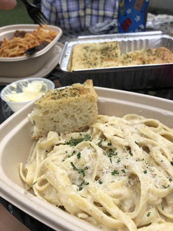 Enjoy Leda Commellini's famous fettuccine Alfredo in the lush outdoor setting of the historic estate. - COMMELLINI ESTATE