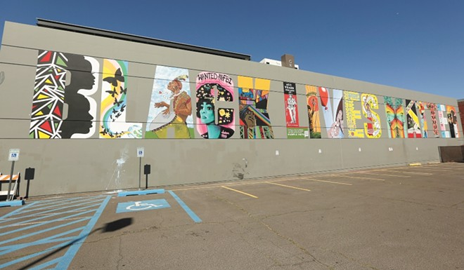 Each letter of the mural was painted by a local artist of color. - YOUNG KWAK PHOTO