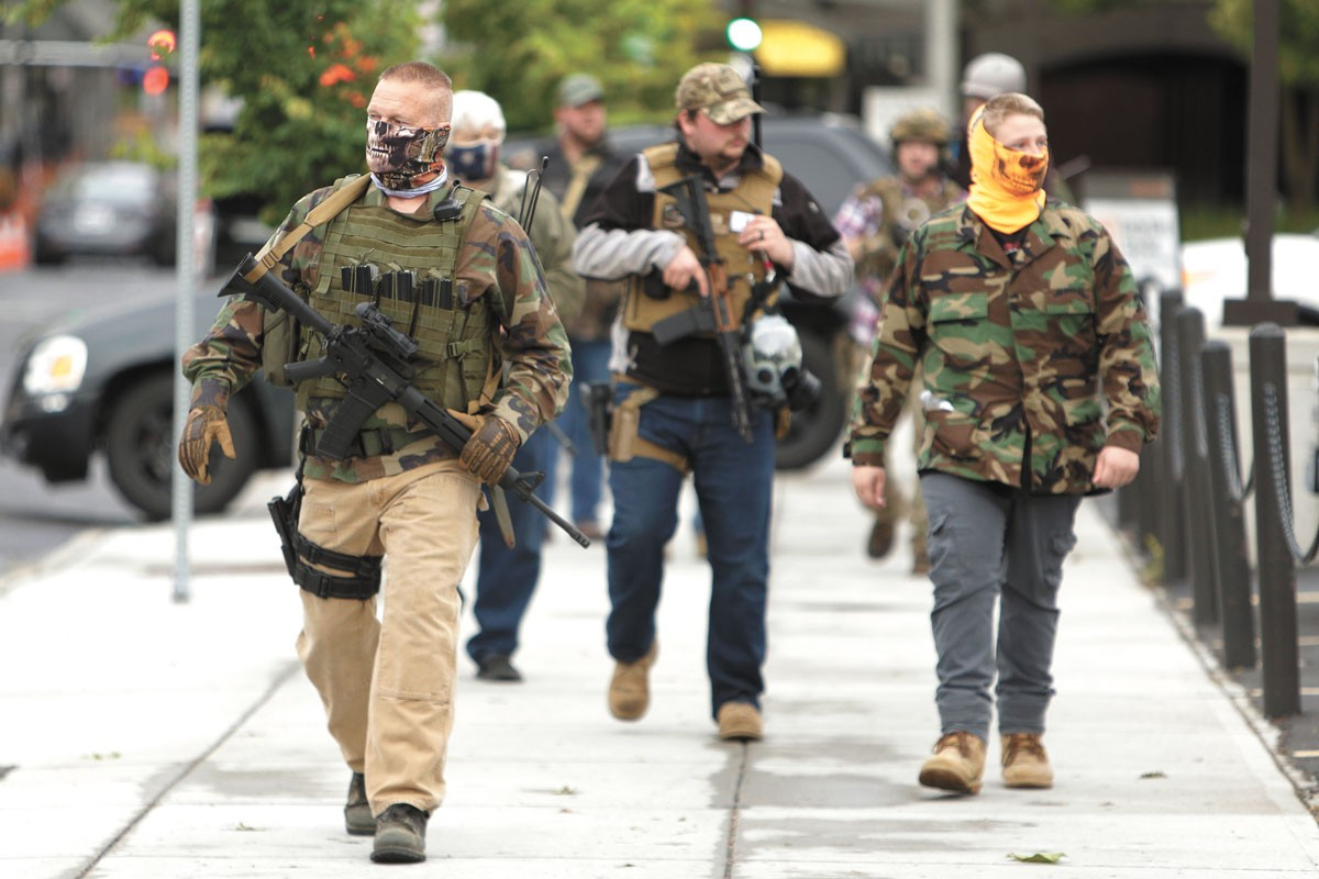 Men who only identified themselves as militia walk through downtown Spokane on June 7. They said that businesses had called them for protection. - YOUNG KWAK PHOTO