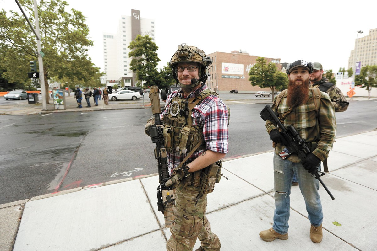 Unidentified armed men roam the streets of downtown Spokane on June 7. - YOUNG KWAK PHOTO