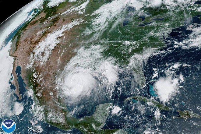 In a satellite image provided by NOAA, Hurricane Hanna approaches the Texas coast on July 25. 2020. Following a record number of Atlantic Ocean storms over the past two months, including five that struck the United States, government scientists updated their forecast for the remainder of the hurricane season on August 6, saying it was likely to be extremely active. - (NOAA VIA THE NEW YORK TIMES