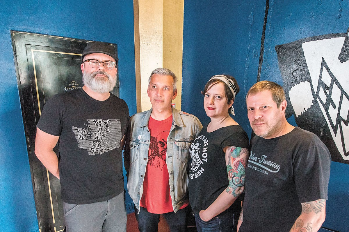 FROM LEFT: Berserk owners Josh Davis, James Hunt, Beth McRae and Lon McRae, photographed in 2018. - ERICK DOXEY PHOTO