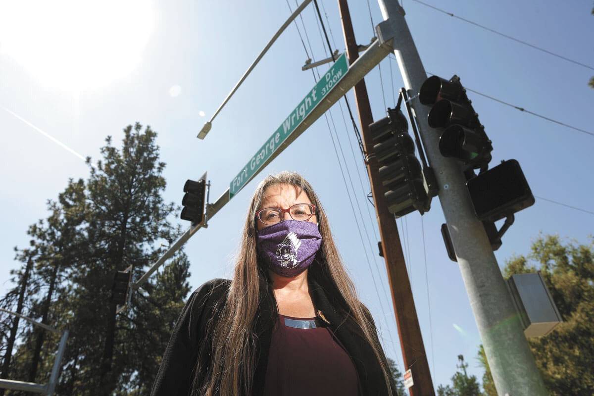 Spokane Tribal Council Chairwoman Carol Evans at a Fort George Wright Drive intersection. The Spokane Tribe of Indians is working with the city to change the name of the road. - YOUNG KWAK PHOTO