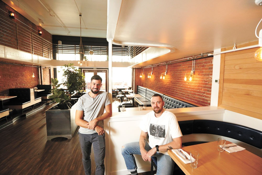 Wooden City co-owners Jon Green (left) and Abe Fox pride themselves on elevated familiar dishes.|YOUNG KWAK photo