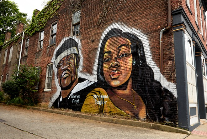 A mural in Louisville, Ky., depicting George Floyd and Breonna Taylor, on June 9, 2020. Floyd died in police custody in Minneapolis in May, and Taylor was killed by the police in Louisville, using a no-knock warrant to enter her apartment with a battering ram, during a late-night drug investigation in March. - ERIK BRANCH/THE NEW YORK TIMES