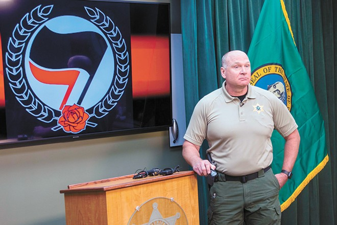 Spokane County Sheriff Ozzie Knezovich speaking to reporters on Sept. 8 about a controversial arrest involving a vocal police critic. - DANIEL WALTERS PHOTO