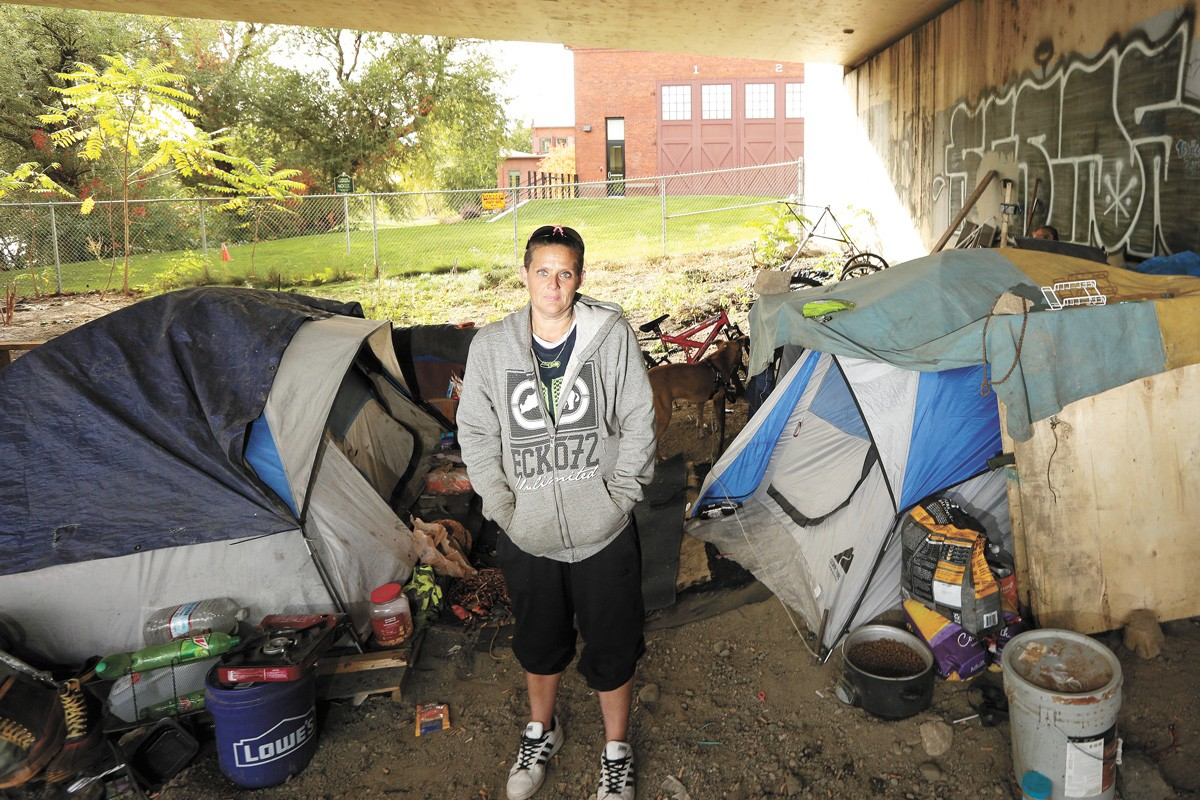 JoAnna Epperson, who has been homeless off and on for 20 years, pictured at camp earlier this week. - YOUNG KWAK PHOTO