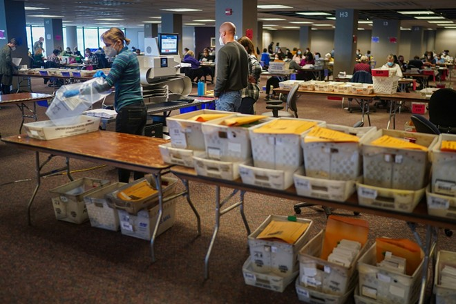 Election workers process mail-in and absentee ballots at the Central Count Facility in Milwaukee, on Election Day, Tuesday, Nov. 3, 2020. - CHANG W. LEE/THE NEW YORK TIMES