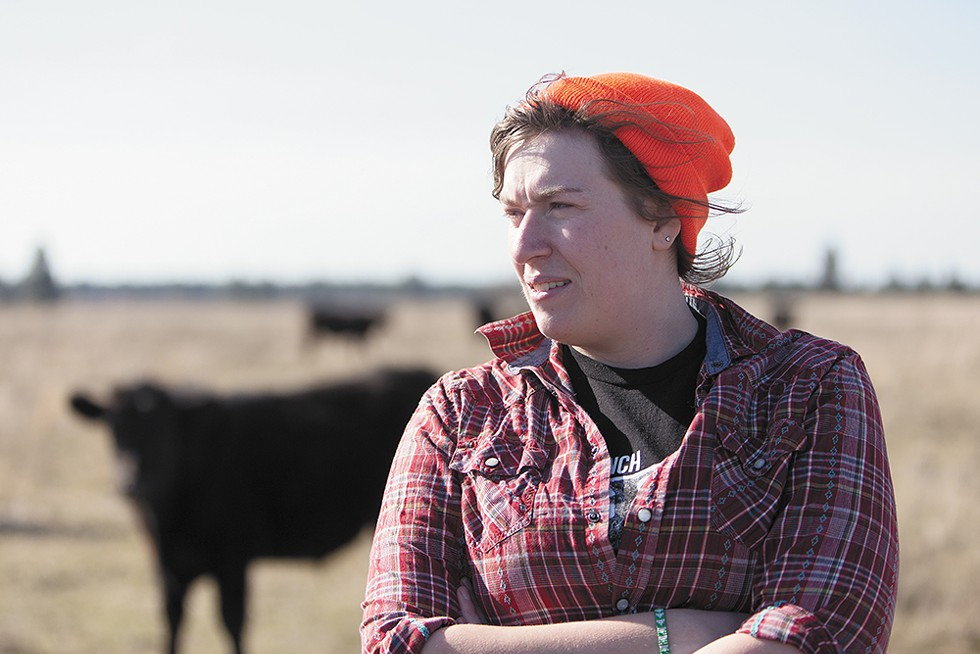 """Fourth-generation rancher Beth Robinette and her father practice """"low-stress cow handling"""" with their cattle. - YOUNG KWAK"""