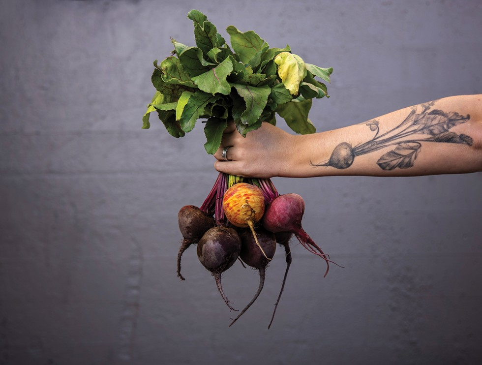 Beth Robinette holds a bunch of beets from Urban Eden Farms, one of the independent producers for Spokane's LINC Foods cooperative. - RAJAH BOSE/HIGH COUNTRY NEWS