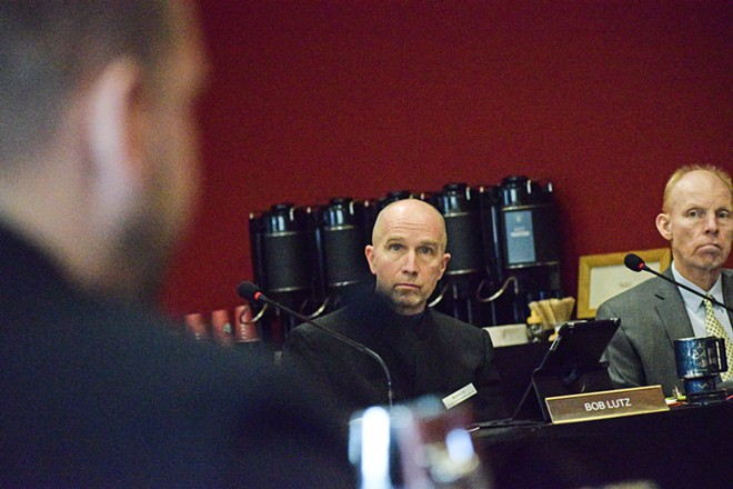 The status of health officer Dr. Bob Lutz, center, is the subject of a special meeting Thursday. - WILSON CRISCIONE PHOTO