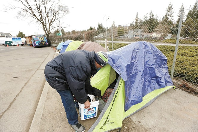 Homeless shelters in Spokane have often been full this year, forcing some people to camp outside - YOUNG KWAK PHOTO