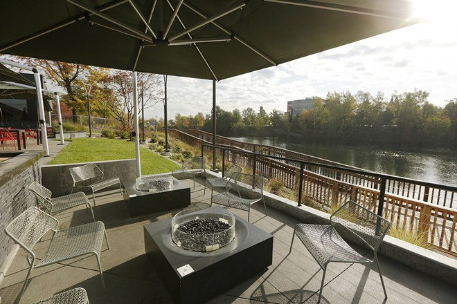 Osprey Restaurant's patio overlooking the Spokane River has heaters and fire pits to keep guests warm. - YOUNG KWAK