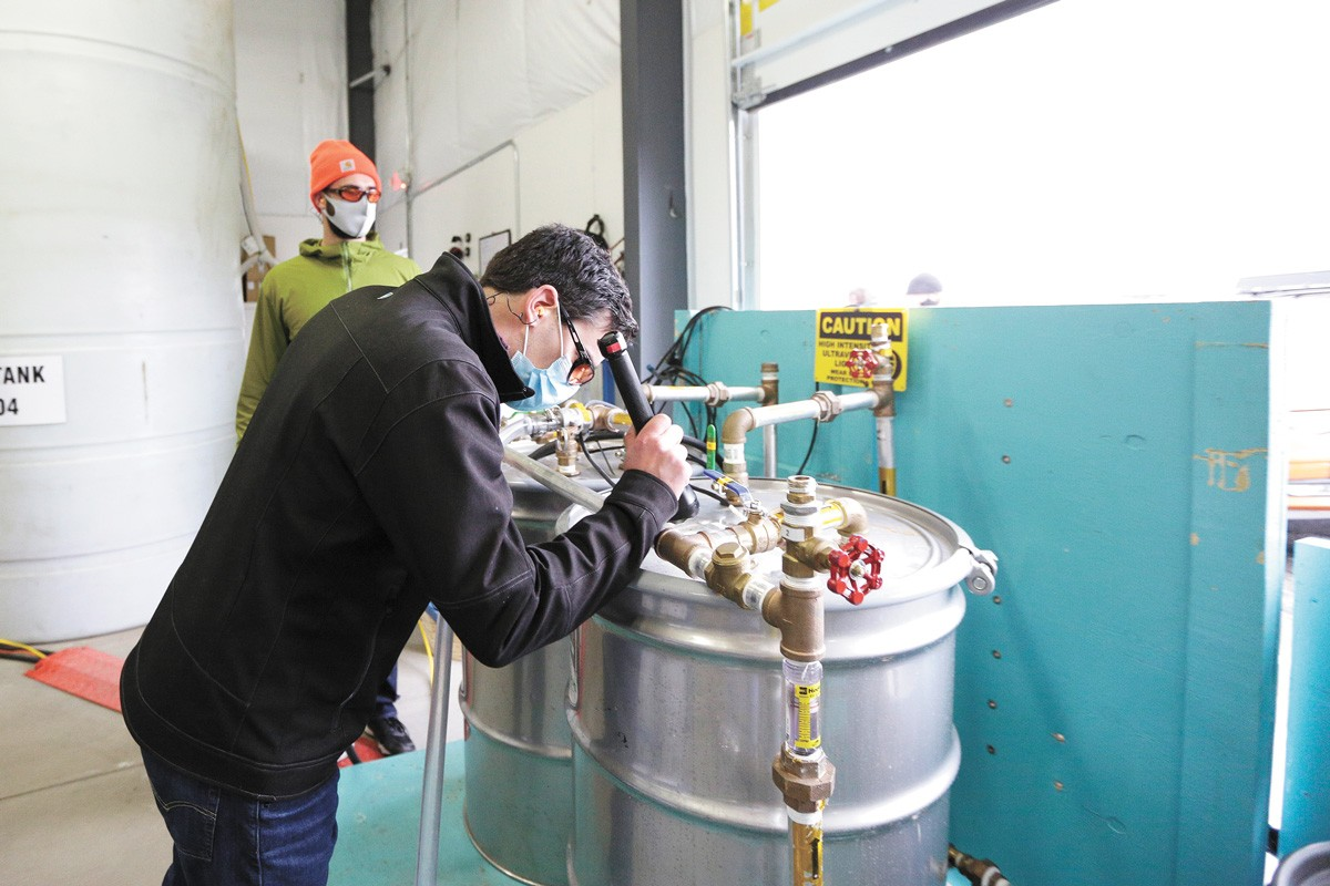 Geologist Ward McDonald checks the water level on a system designed to break down PCBs found in the ground at Kaiser Aluminum. - YOUNG KWAK PHOTO