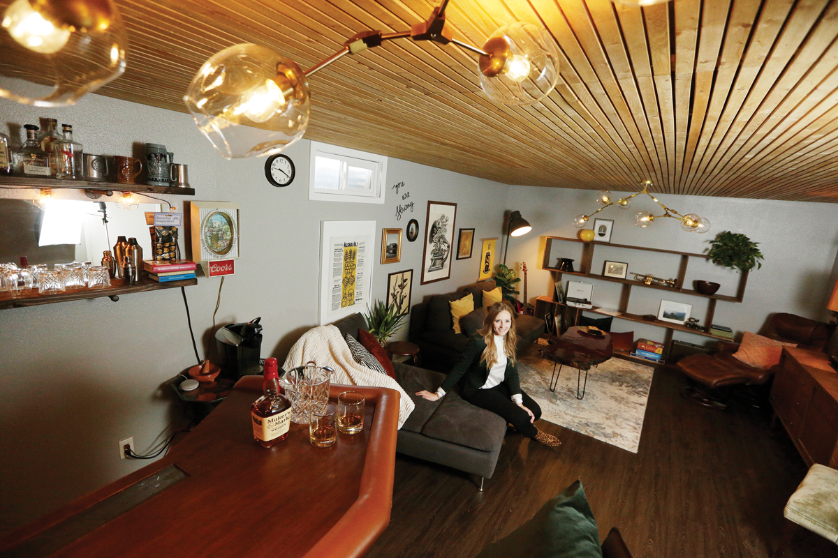 A wood-planked ceiling adds to the cozy ambiance of designer Katie Getman's basement lounge. - YOUNG KWAK PHOTO