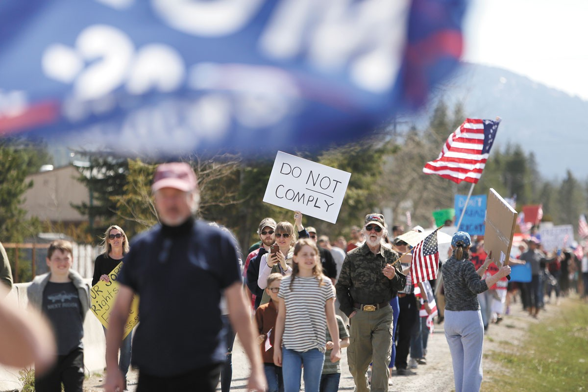Protesters marching in April against Idaho's stay-home order aimed at slowing the spread of COVID-19. - YOUNG KWAK PHOTO