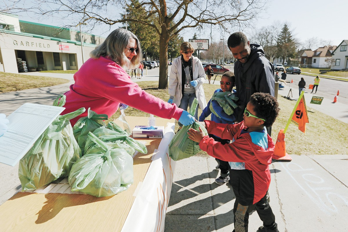 Meal distribution at a Spokane school. - YOUNG KWAK PHOTO