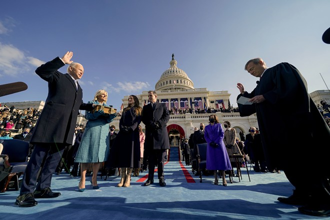 President Joe Biden, left, is sworn in by Supreme Court Chief Justice John Roberts, right, at the U.S. Capitol on Wednesday, Jan. 20, 2021. Looking on are Biden's wife Jill Biden, second from left, daughter Ashley Biden, third from left; son Hunter Biden, center; and Vice Kamala Harris, second from right. - ANDREW HARNIK/POOL VIA THE NEW YORK TIMES