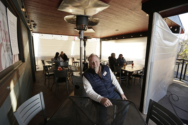 Rock City Grill owner Jim Rhoades is pictured on the South Hill restaurant's patio. - YOUNG KWAK