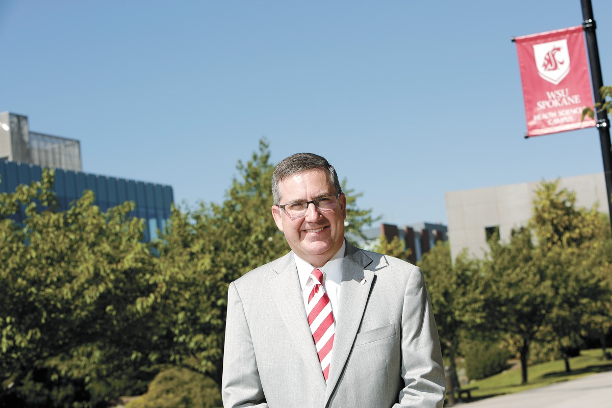 WSU President Kirk Schulz and other administrators argue that a competitive athletics program brings outsized returns in national recognition, student recruitment and intercollegiate partnerships. - YOUNG KWAK PHOTO