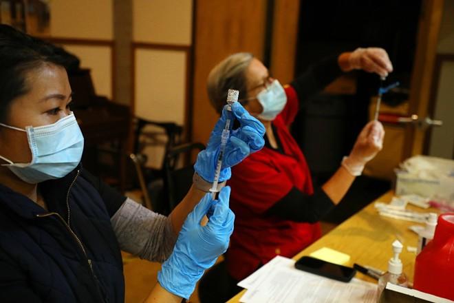 A coronavirus vaccine is prepared at a vaccine center in Rohnert Park, Calif., Jan. 27, 2021. - JIM WILSON/THE NEW YORK TIMES