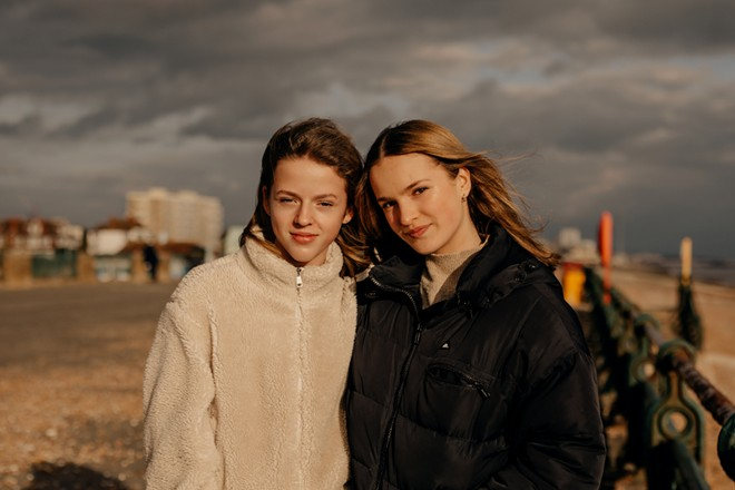 """Sisters Elodie and Mireille, who started a literary-themed TikTok account together, in Hove, England, March 15 2021. """"BookTok"""" videos are starting to influence publishers and best-seller lists, and the verklempt readers behind them are just as surprised as everyone else. - PETER FLUDE/THE NEW YORK TIMES"""