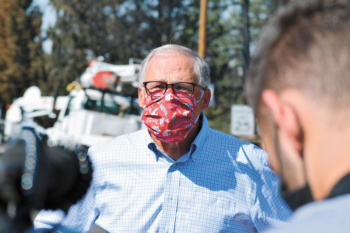 Washington Gov. Jay Inslee, sporting a mask during a visit to Malden in September after the devastasting wildfires. - WILSON CRISCIONE PHOTO