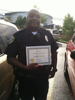 Officer Curtis Tucker, later accused by multiple women of domestic abuse, received a certificate of appreciation from the YWCA in 2013.